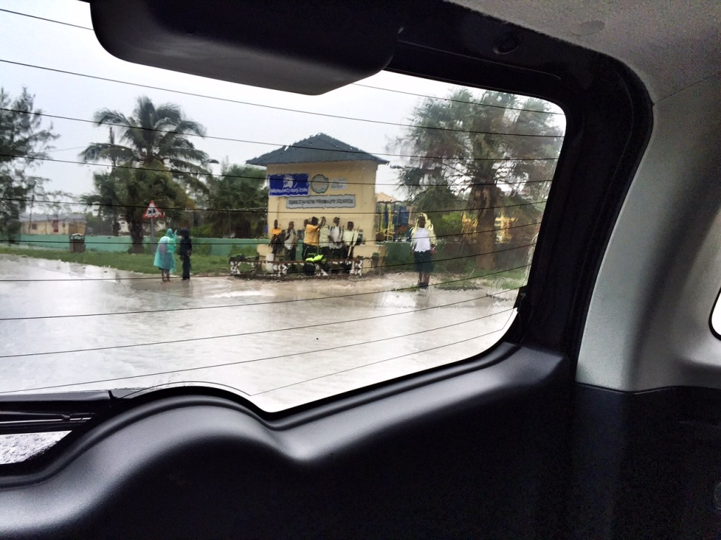 Kids waiting for the school bus during a storm in the Turks and Caicos