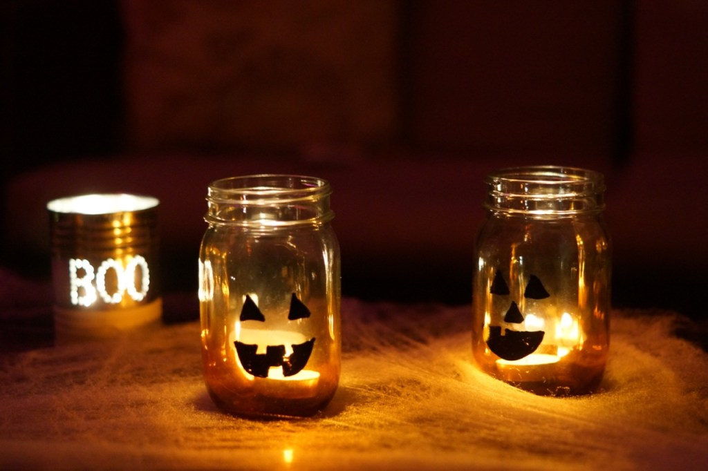 Fun jack-o-lantern mason jar candle holders on Halloween Night