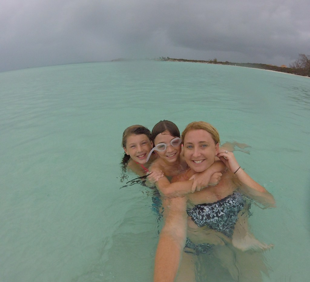 Mom and kids playing in the waters in the Turks and Caicos