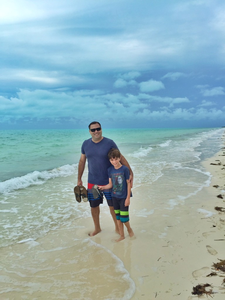 Steve and Tyler walking along Long Bay Beach in the Turks and Caicos