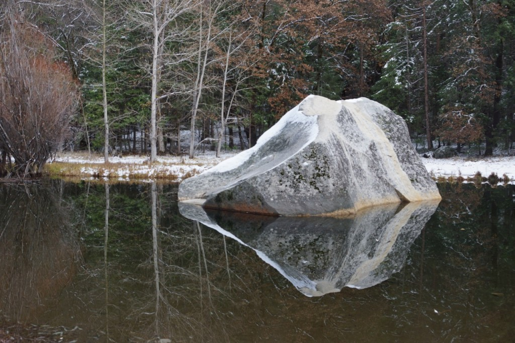 Beautiful rock in the middle of mirror lake