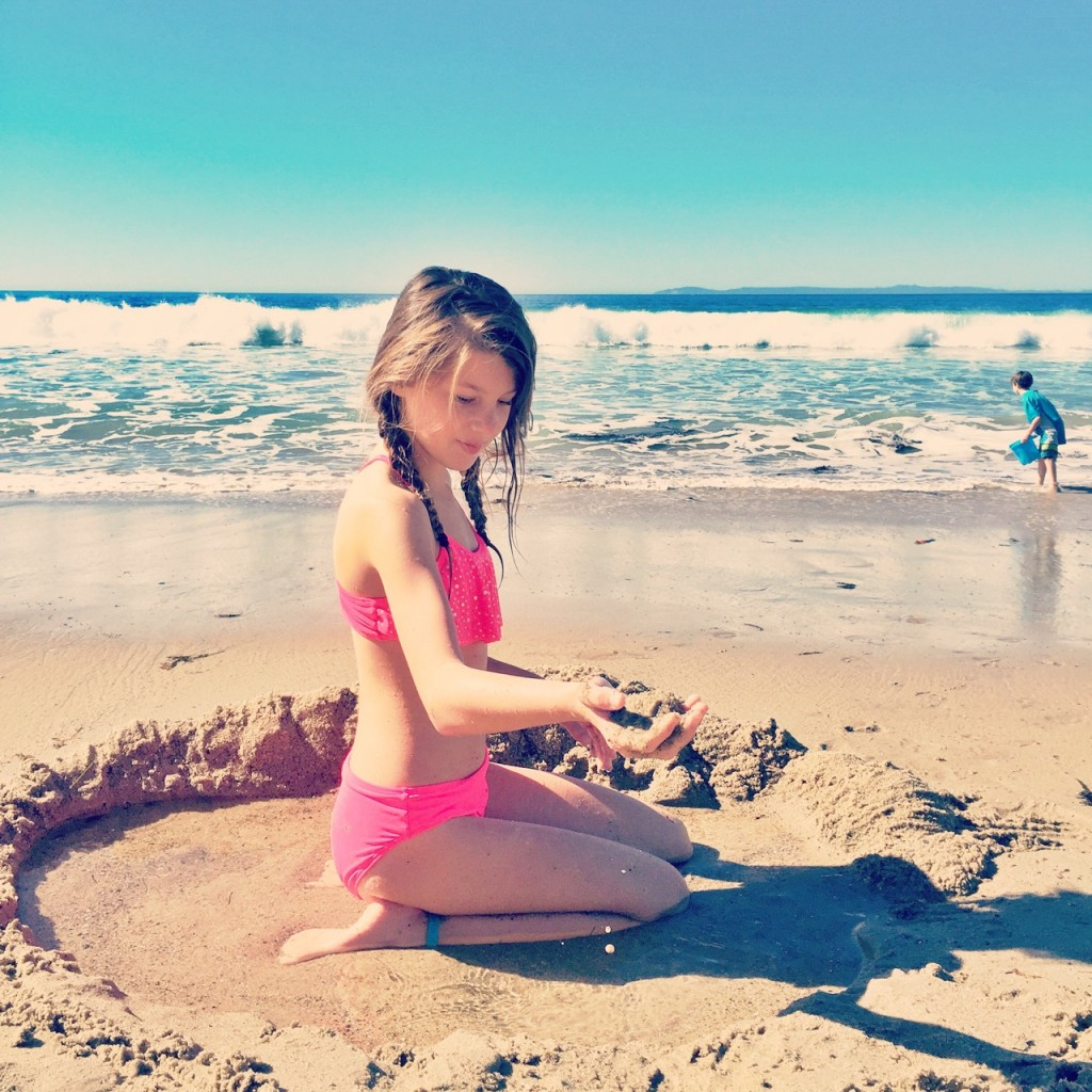 Playing in the sand at the Pacific Edge