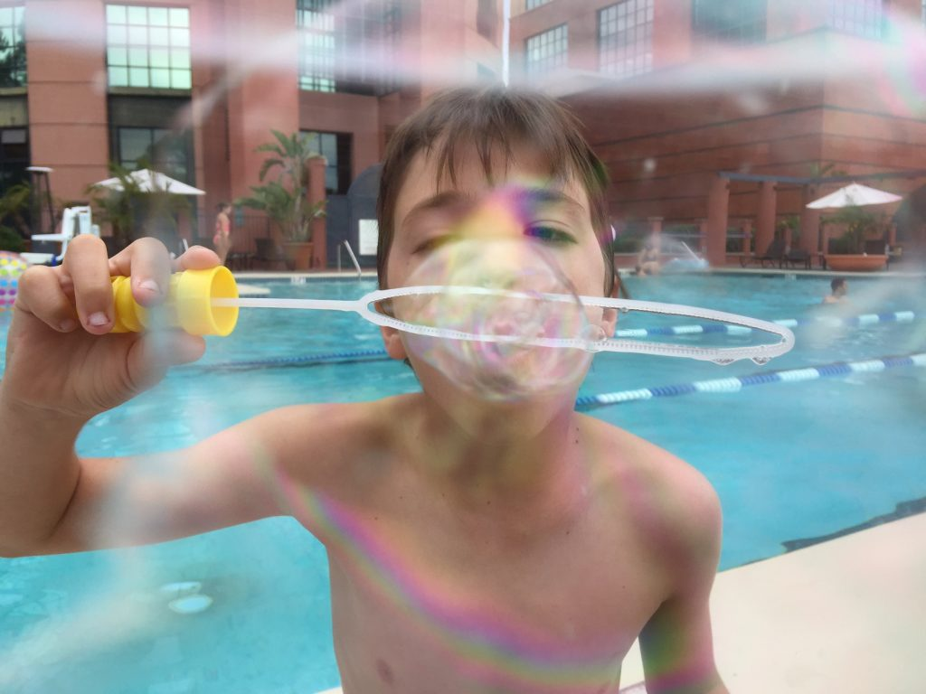 Blowing bubbles at the pool in La Jolla