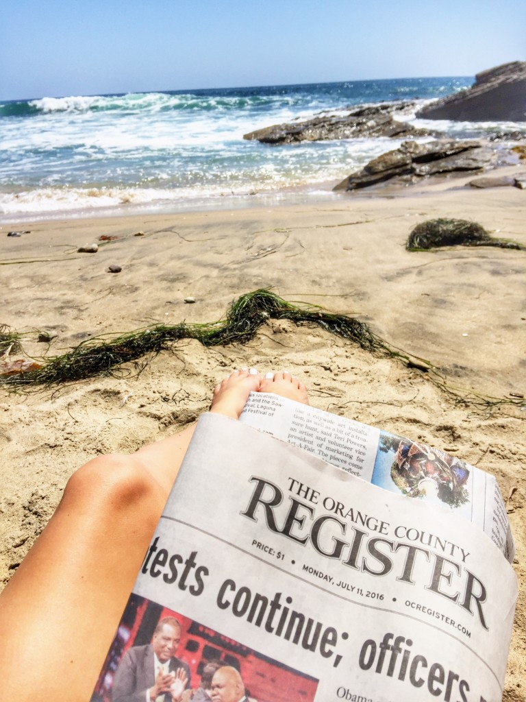 OC Register and toes in the sand