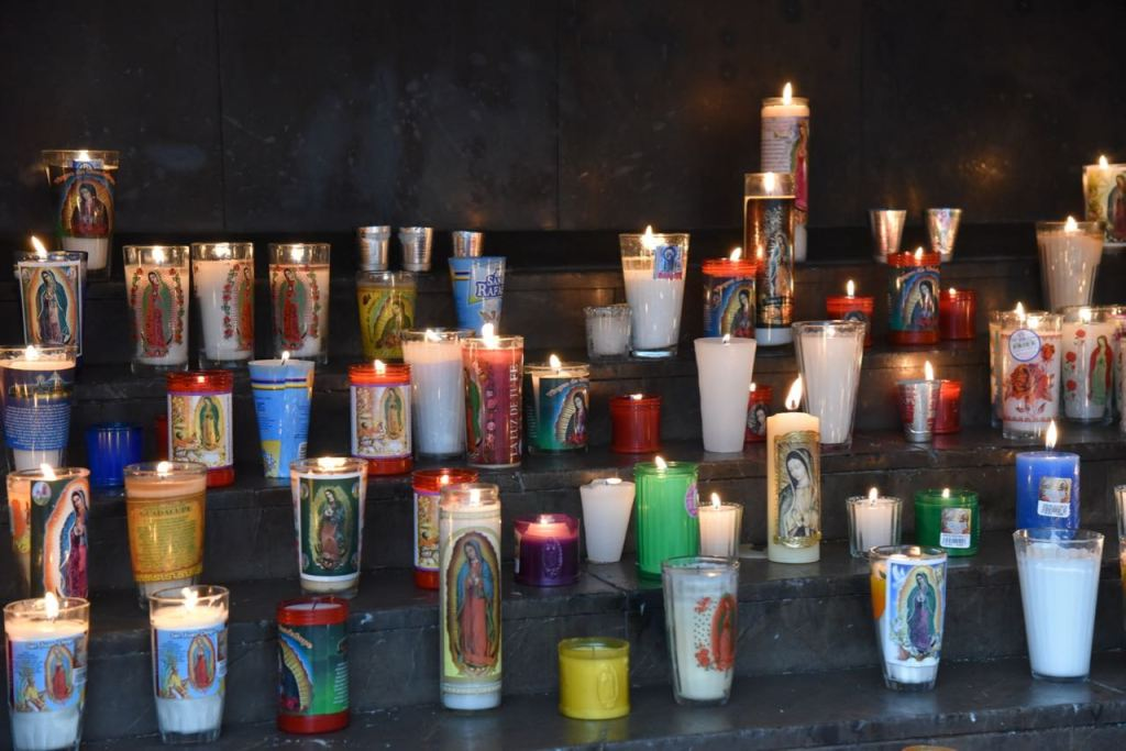 Candles burning inside of The Old Basilica of Our Lady of Guadalupe