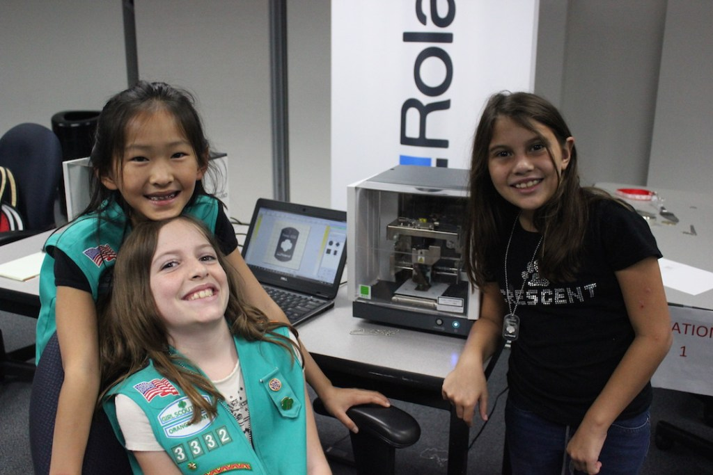 girl-scout-juniors-using-roland-dgas-impact-printer-to-make-custom-metal-pendants-and-earn-their-stemsational-me-badge