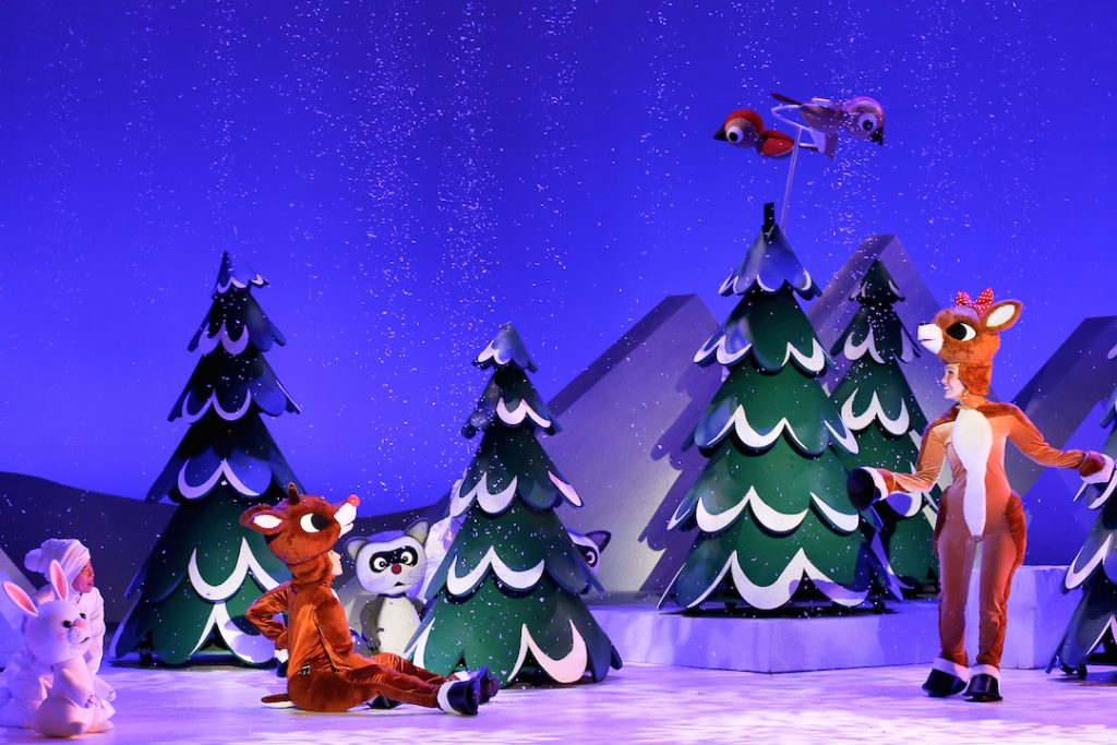 Rudolph in the forest in Rudolph the Red-Nosed Reindeer: The Musical
