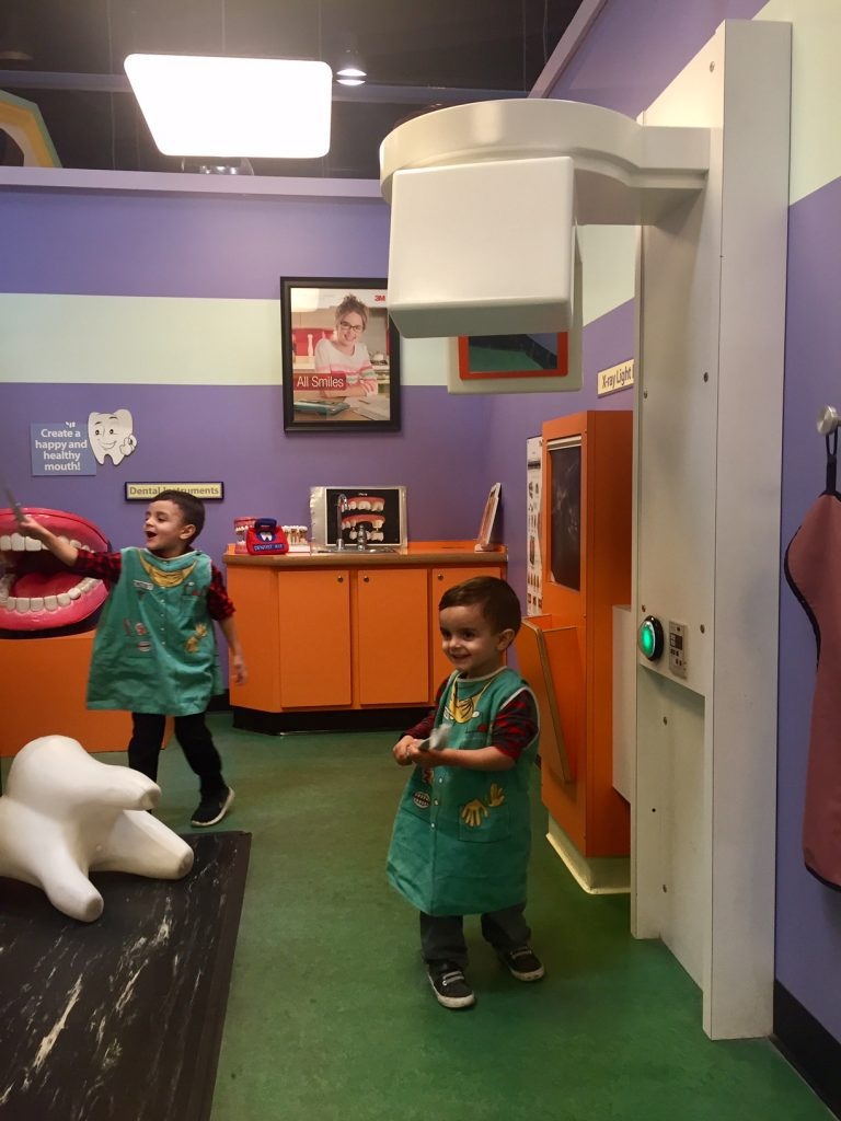 Playing in the dentist office at Pretend City
