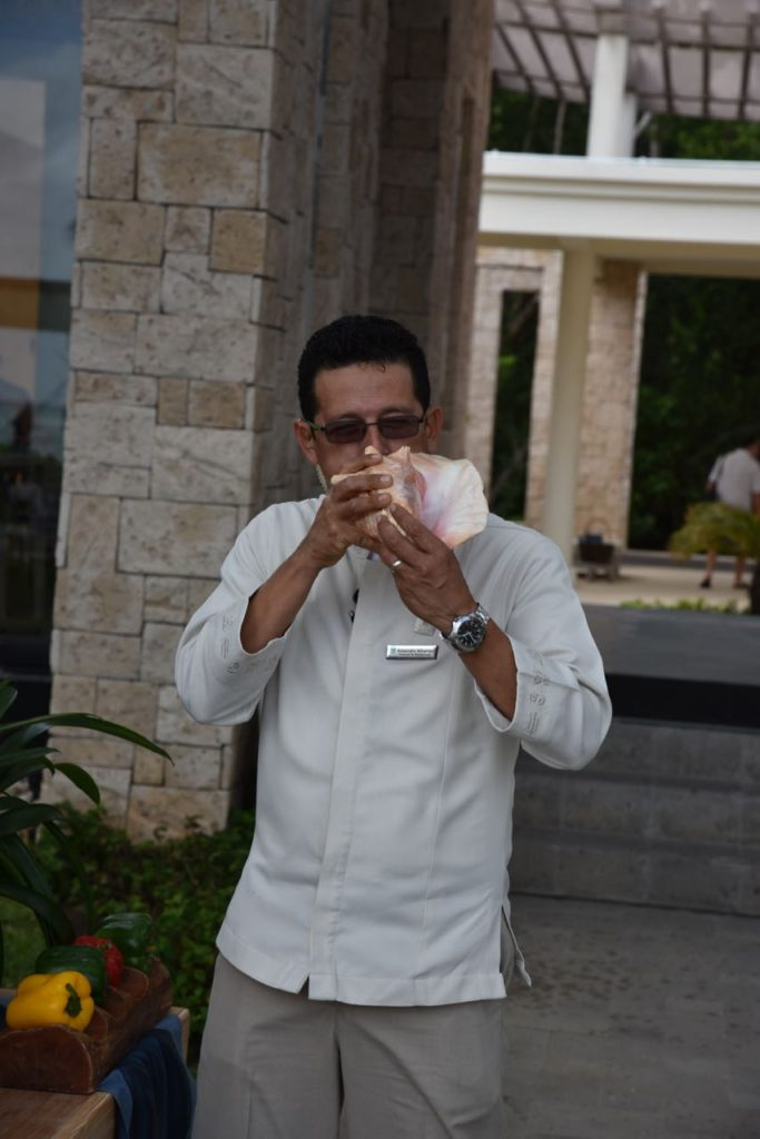 Blowing a horn to signal lunch at Banyan Tree Mayakoba