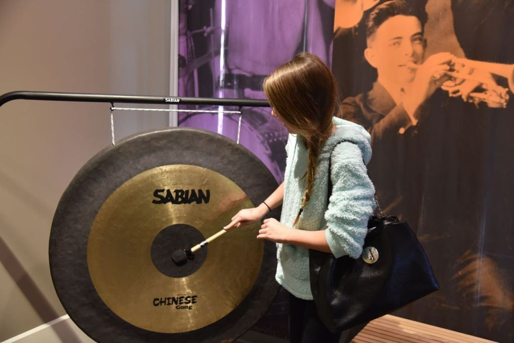 Hitting a gong at the Museum of Making Music in Carlsbad