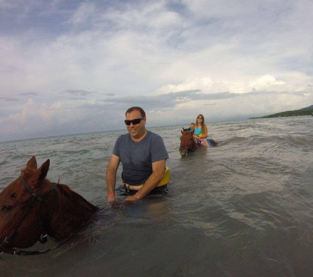 Riding horses into the water in Jamaica