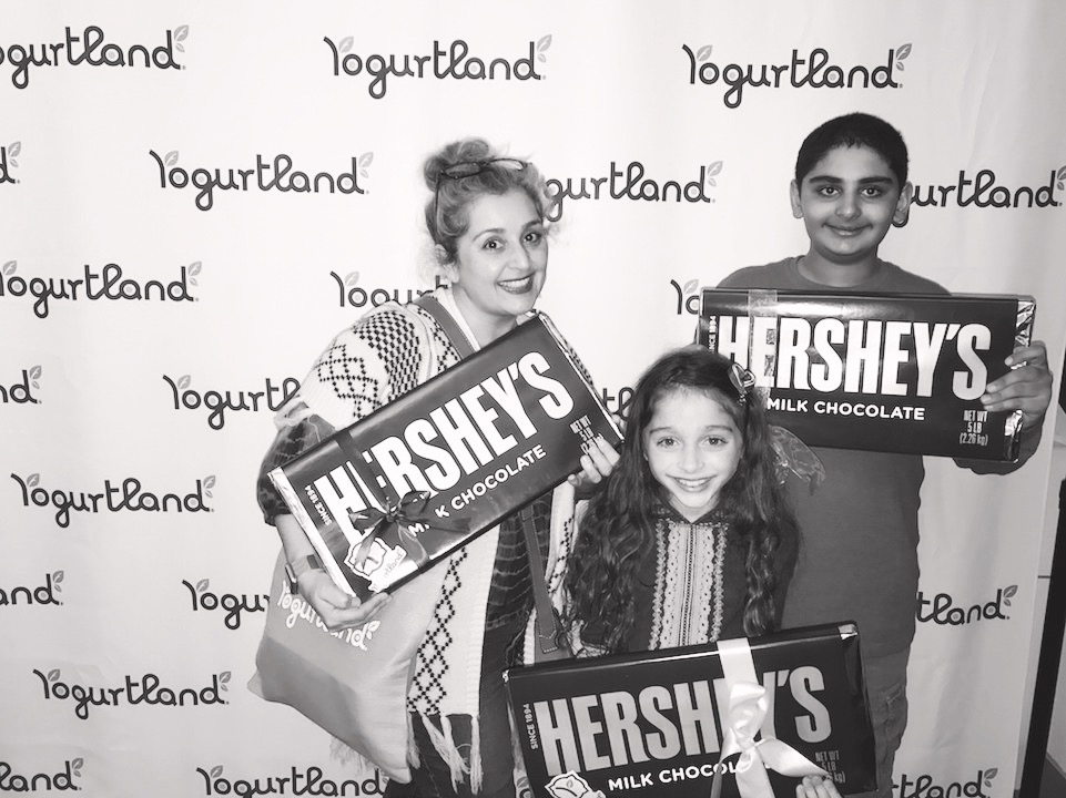 Naz Nodjoumi and her family at a Yogurtland Celebration