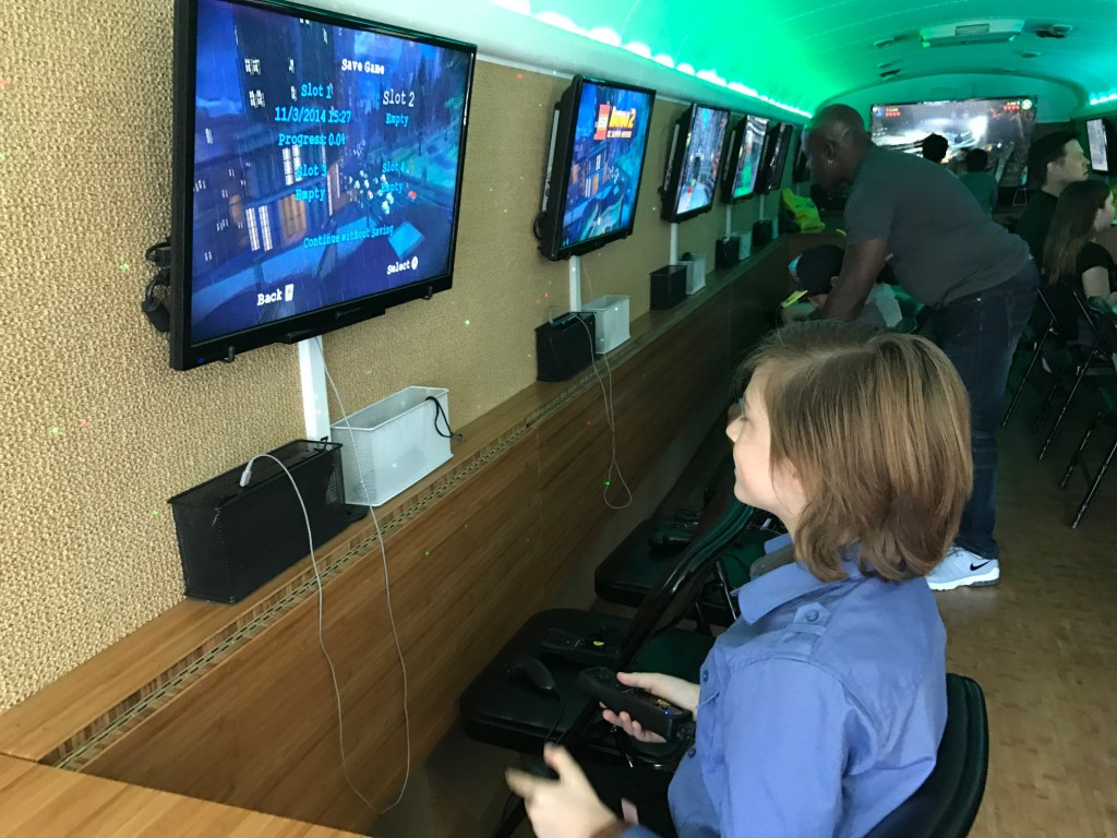 Playing Lego video games at The Lego Batman Movie Premiere