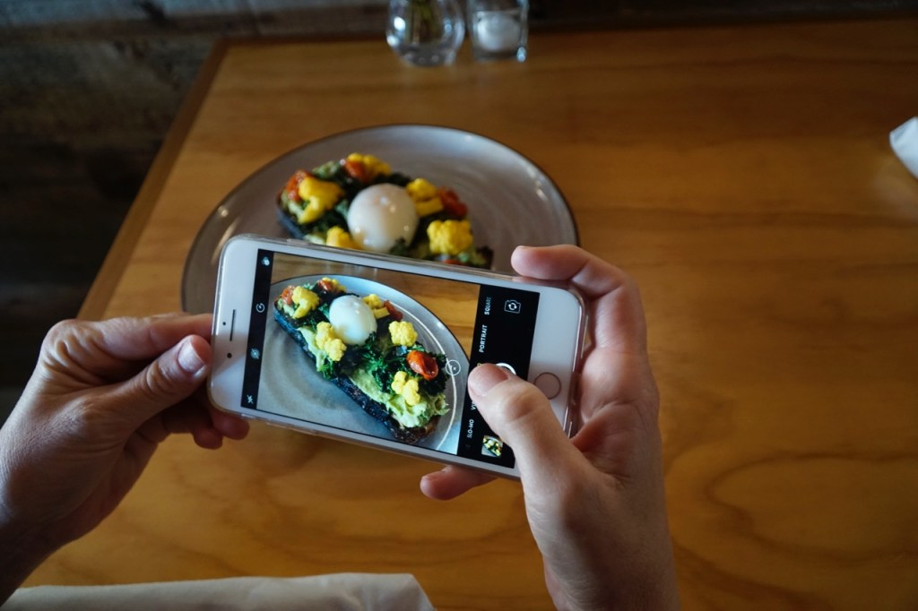 Taking pictures of the food at Toast in Orange County