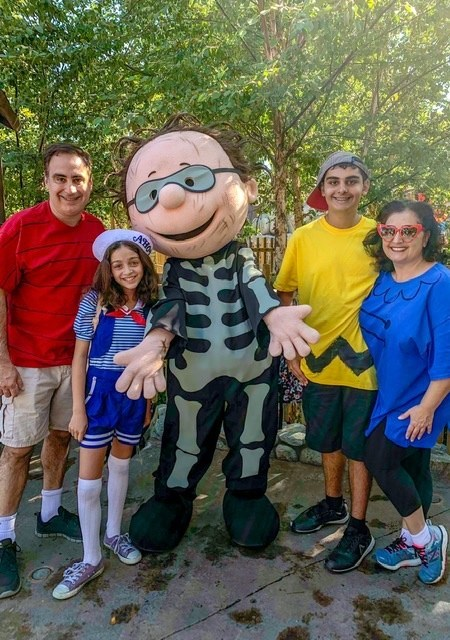 Family dressed at the Peanuts Gang