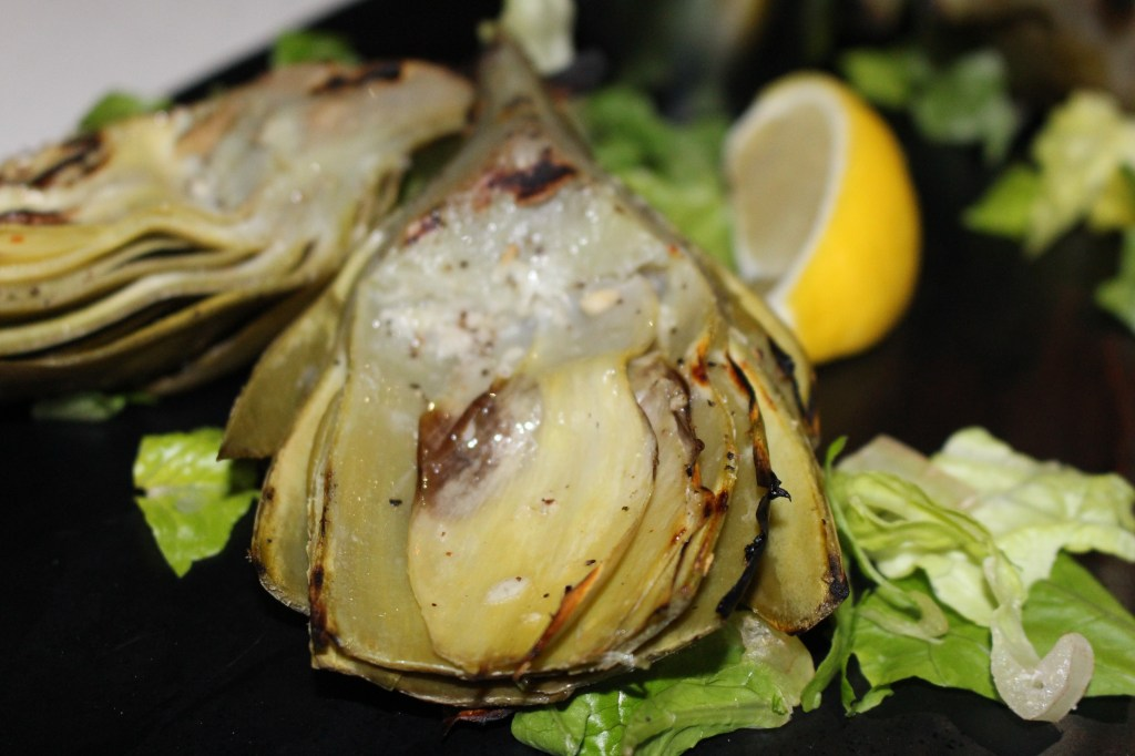 Grilled artichoke quartered and brushed lightly with a light garlic and lemon aioli