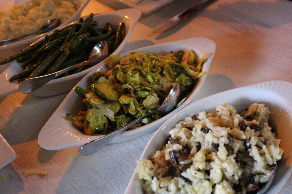 sautéed bacon green beans, Brussels sprouts, garlic mashed potatoes, and bleu cheese mushroom risotto.