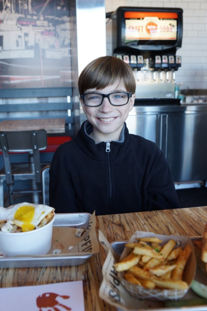 Kid enjoying eating at Slapfish
