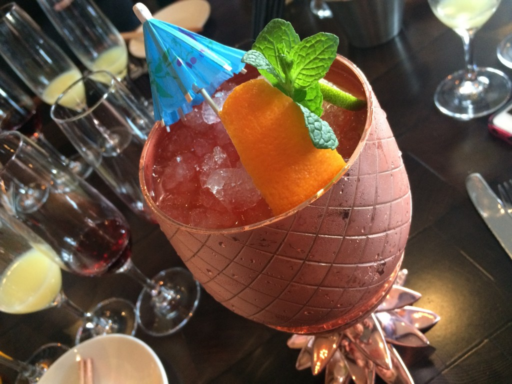 copper pineapples filled with Absolut Elux Vodka, Corruba Coconut Rum, passion fruit, fresh lime juice, allspice rum liqueur, floral bitters and orgeat