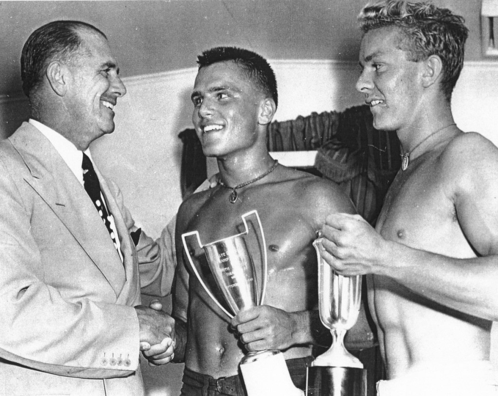 John B. Kelly congratulates his son Jack (middle) and Joe Regan after they won the South Jersey doubles rowing race on September 1, 1944.