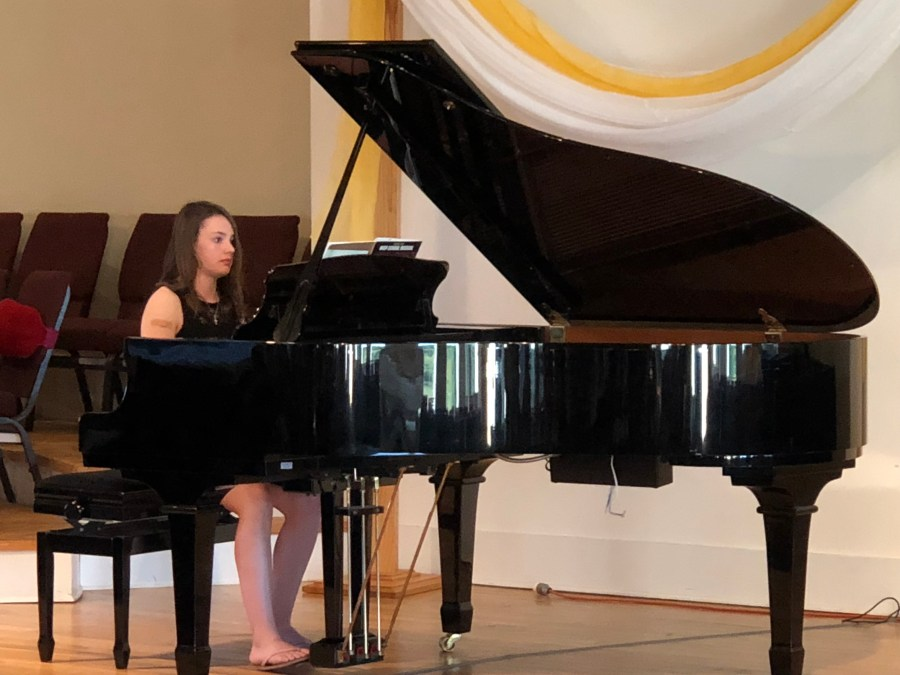Girl playing piano at recital   Oconee Music performances