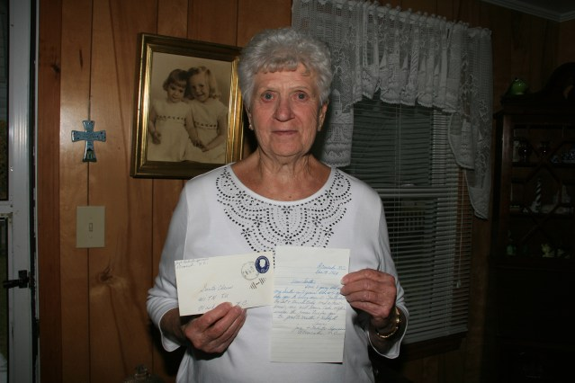 Joyce Midgette Spencer, who recently retired from working in the hardware section of the Variety Store, with her children's found letters to Santa. Photo by  Trudy Austin