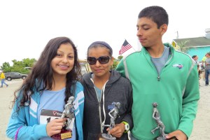 Three Perez family race winners are daughter Karen, second-place finisher  for women in the 5K, mom Lulu, female winner of the 10K and overall fifth place finisher, and son Kevin, men's 5K winner.  Photo by C. Leinbach