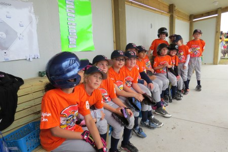 The all-girls Hatteras team the Mets await their turn against the Ocracoke Blue Claws.