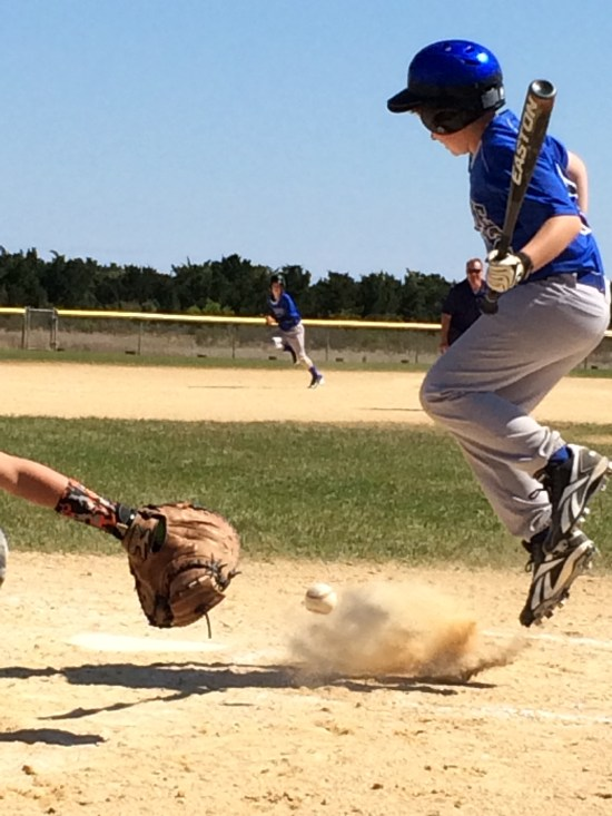 Kari Styron photographs her son, David, leaping to avoid being hit by a pitch.