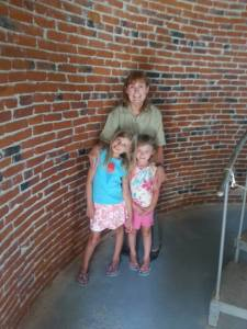 Lou Ann Homan-Saylor with Holly and Brianna Homan inside the Ocracoke lighthouse. Photo by Philip Howard