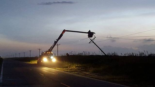 Ocracoke Tideland EMC workers fix downed poles on the island Saturday night. Photo by Rachel O'Neal, Tideland EMC