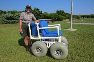 NPS ranger Deidra Smith with the beach-going wheel chair stored at the campground. Photo by C. Leinbach