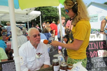 North Carolina food writer and UNC-TV host Bob Garner, a celebrity judge for the Fig Cake Bake-Off, is interviewed by Daphne Bennink for Ocracoke's community radio WOVV 90.1 FM.