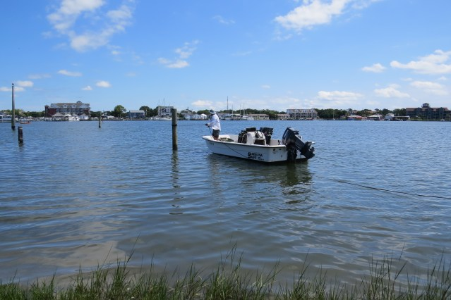 'Clamlady Jane' prepares her boat for a trip to Devil Shoals. Photo by C. Leinbach