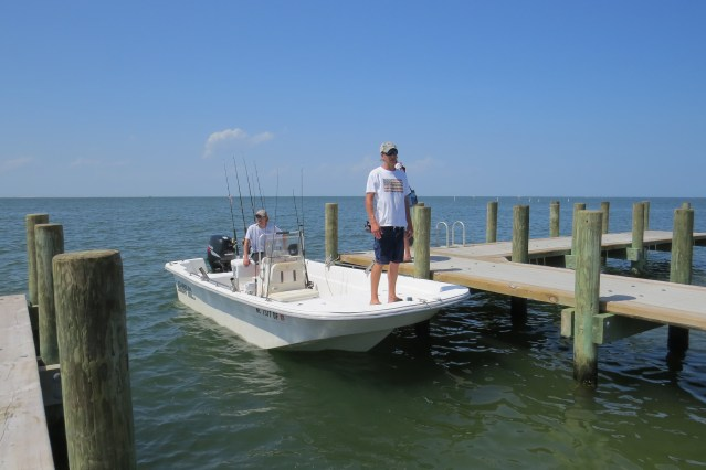 Tyler and Chris (standing) Blue, visiting from Fayetteville, had difficulty launching their small boat in July. 'It doesn't get deep fast enough,