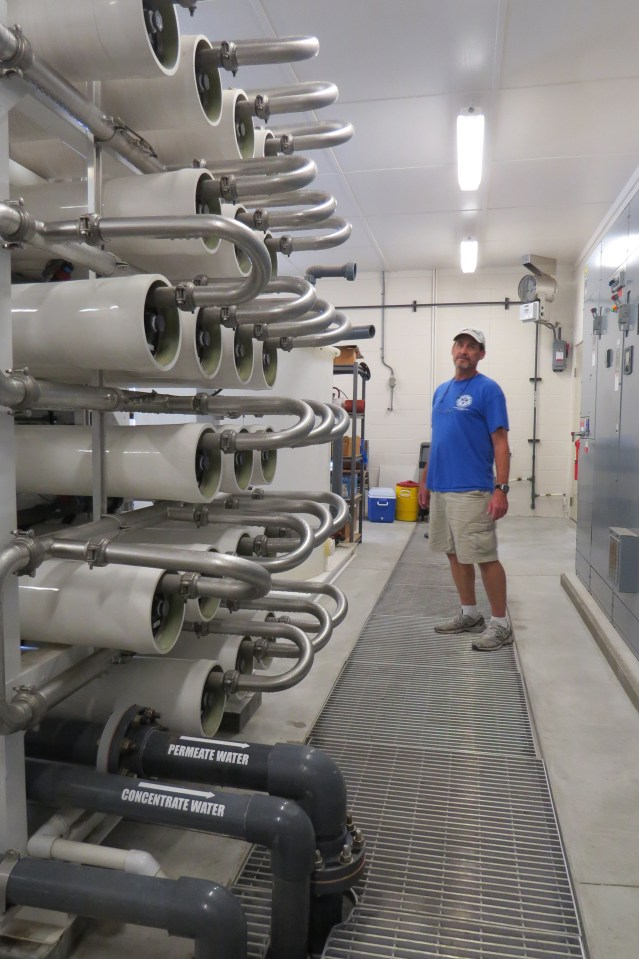 Water plant manager David Tolson checks the machinery that pushes salt water through membranes that turn it into fresh, drinking water.