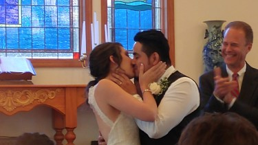 Kiss of the year. Courtney and Freddy Conreras are now man and wife. Photo by P. Vankevich