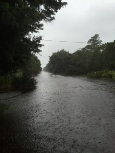 Kevin Pfeiffer slogs back home around noon today along Sunset Drive, which is now a river.