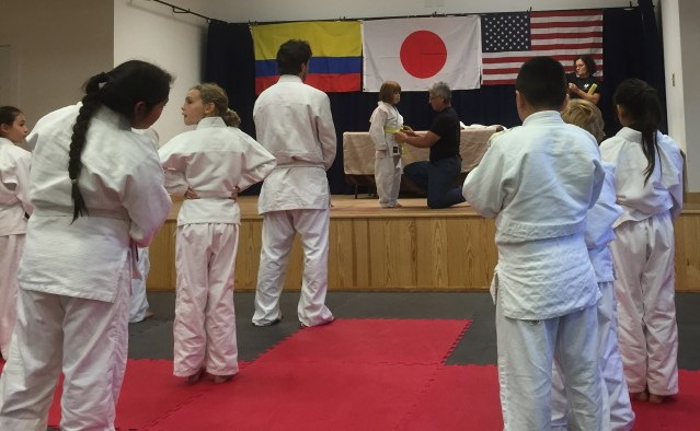 Zoe Modlin gets her yellow belt.