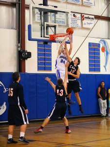 Evan Caswell goes up for a dunk. PHoto by Brian Carter