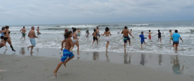 You can't just stroll into the water on New Year's Day. Polar Plungers have to run.