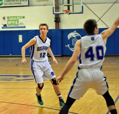 Dolphins Dalton Kalna (40) and Evin Caswll (40). Photo by Melinda Fodrie Sutton