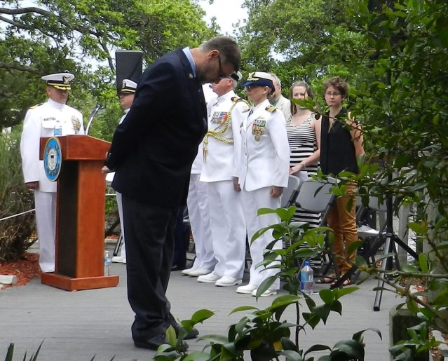 Richard Eagles or Margate, Fla., bows before the commemorative wreaths in honor of the Royal Navy Patrol Service of which the Bedfordshire was a part. Eagles' uncle, Jeffrey Palmer of England, was a member of the service.