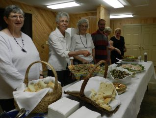 Volunteers help serve at the reception in the Ocracoke Community Center following the ceremony.