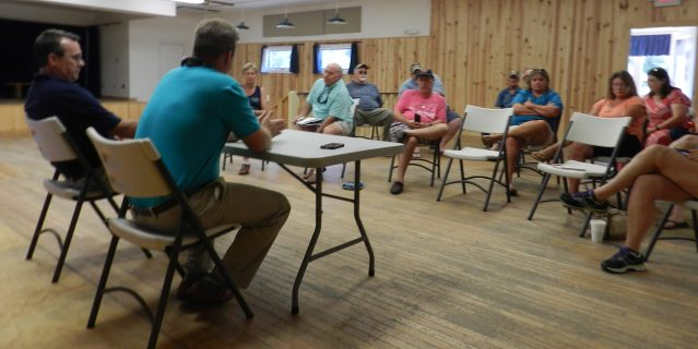 Ferry officials, Chris Bock, front left, Hatteras Ferry terminal superintendent, and Jed Dixon, front right, deputy Ferry Division director, meet with Ocracoke islanders Monday in the Community Center. Photo: C. Leinbach