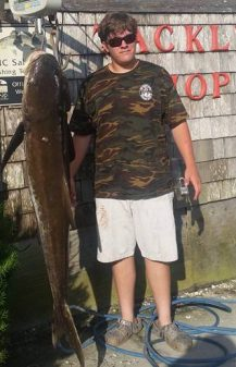 Spencer Gaskins with a large cobia caught on Ocracoke.