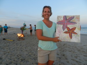 Erin McKloskey of Hollidaysburg, Pa., shows the painting she rescued from Mitchell's fire.