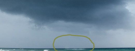 waterspout with spray circled