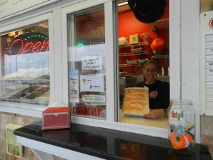 Dana Long awaits customers for ice cream fresh batches of fudge at The Fudge and Ice Cream Shop in Community Square. Photo: C. Leinbach