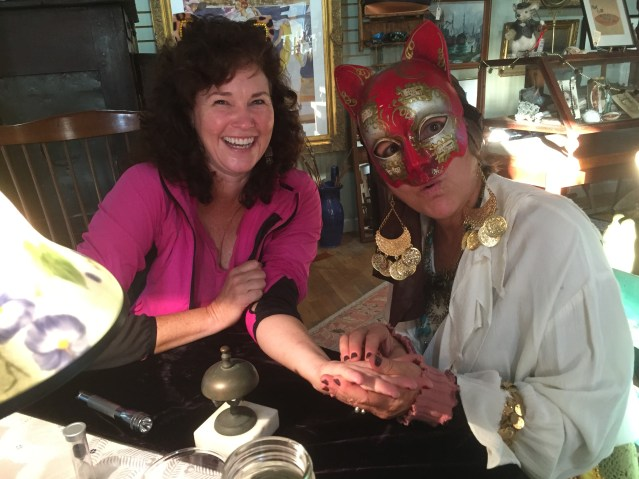 Melinda Sutton learns her fortune with 'Zelda the Gypsy,' who will read palms this Saturday (Oct. 22) at Roxy's Antiques in Spencer's Market. Photo: C. Leinbach